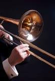 Trombone op zwarte Stock Afbeeldingen