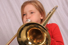 Trombone player 15. Young girl playing a trombone stock photo