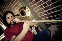 A trombone player Royalty Free Stock Image