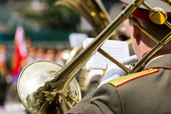 Trombone player in military band Stock Photography