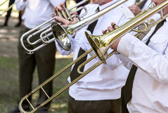Trombone players of military brass band Stock Images