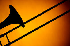 Trombone Silhouette Isolated On Gold Stock Images