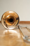 Trombone on wooden floor detail Royalty Free Stock Image