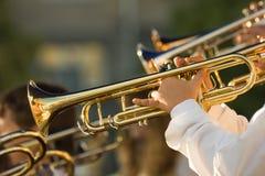Trombones del oro Imagenes de archivo