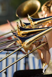 Trombones del oro Foto de archivo libre de regalías