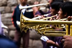 Trombones playing in a big band. Royalty Free Stock Image