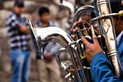 Trombones playing in a big band. Stock Photos