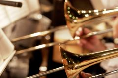 Trombones Playing in a Big Band (shallow focus). Close-up of trombones playing in a big band orchestra (shallow focus stock photos