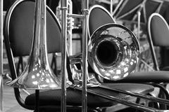 Trombones on stage in the orchestra. In black and white tones Stock Image