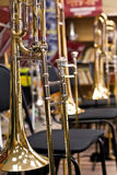 Trombones standing on stands Royalty Free Stock Photos