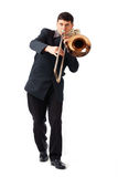 The Trombonist. Young man playing his trombone Stock Image