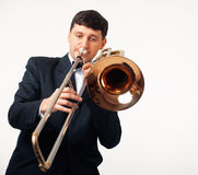 The Trombonist. Young man playing his trombone Royalty Free Stock Photography