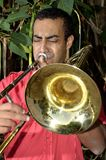 Trombonist is exercised by the trombone. Stock Images
