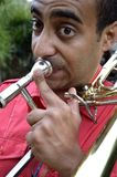 Trombonist is exercised by the trombone. Royalty Free Stock Photo