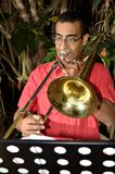 Trombonist is exercised by the trombone. Stock Photography
