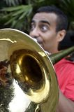 Trombonist is exercised by the trombone. Royalty Free Stock Images
