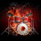Trommels in brand Stock Afbeeldingen