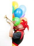 Trompeta que sopla del bufón Imagen de archivo libre de regalías