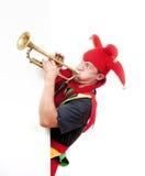 Trompeta que sopla del bufón Imagen de archivo