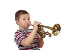 Trompeta que sopla del muchacho Fotos de archivo libres de regalías
