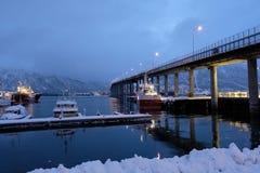 Tromso boat under the bridge royalty free stock images