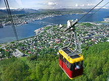 Tromso cable car. A cable car going up with Tromso panorama in the background Stock Photography