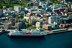 Tromso city in Norway. Aerial view of cruise ship moored next to Tromso city center, Norway Stock Photography