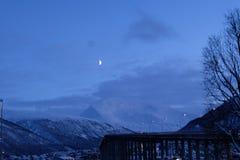Tromso daylight winter bridge and mountain royalty free stock photos