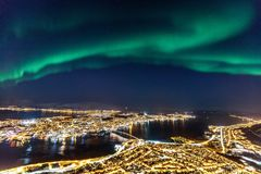 Tromso in Northern Norway. Incredible Northern lights Aurora Borealis activity above town of Tromso in Northern Norway stock photo