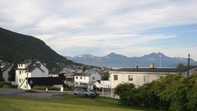 Tromso. A part of Tromso city, near to Ishavskatedralen, view of massive and snowed mountains around, Norway Royalty Free Stock Image