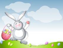 Tronçonnement de lapin de Pâques avec le panier des oeufs Photographie stock libre de droits