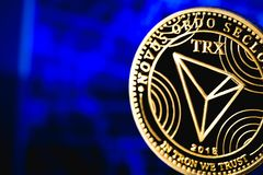 Tron coin cryptocurrency. On the blue background royalty free stock photos