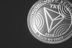Tron cryptocurrency. On the black background stock image