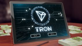 Tron cryptocurrency logo on the pc tablet display. 3D illustration. Tron cryptocurrency logo on the pc tablet display. Neon bright symbol, buy and sell buttons stock photos