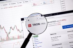 Tron price under magnifying glass. MONTREAL, CANADA - JUNE 20, 2018: Tron crypto currency price under magnifying glass. Cryptocurrency is a digital currency in royalty free stock images