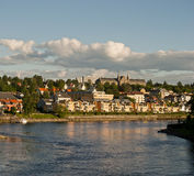 Trondheim river in Norway. Trondheim canal with boats and wooden houses Stock Image