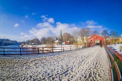 TRONDHEIM, NORWAY - APRIL 04, 2018: View of old wooden bridge Gamle Bybro over a nidelva river in Trondheim. Norway Stock Photography