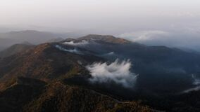 Troodos mountain scenery with low clouds at sundown. Cyprus