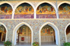 TROODOS MOUNTAINS, CYPRUS – NOVEMBER 18, 2015: The arcades inside Kykkos Monastery with colorful mosaics. The arcades inside Kykkos Monastery with colorful Stock Images