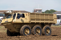 Troop carrier. WESTERNHANGER, UK - JULY 19: An ex British army Alvis Stalwart amphibious troop carrier is driven around the main arena for the public to watch at Stock Photography