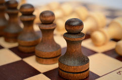 Troop pawns on a chessboard. Royalty Free Stock Images