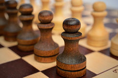 Troop pawns on a chessboard. Stock Photography