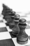 Troop pawns on a chessboard. Royalty Free Stock Photo