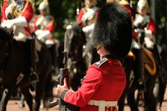 Trooping the Colour ceremony, London UK. Soldier stands to attention. Trooping the Colour ceremony, London on a sunny day. The impressive display of pageantry Stock Photos