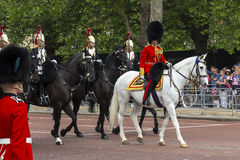 2016 Trooping the Color ceremony during Sovereign's official birthday. The Blues and Royals and guard in Bearskin riding horses along The Mall during Trooping Stock Photography