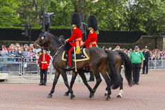 2016 Trooping the Color ceremony during Sovereign's official birthday. Guards in Bearskins riding horses along The Mall during Trooping the Color ceremony, in Royalty Free Stock Photos