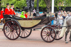 2016 Trooping the Color ceremony during Sovereign's official birthday. Queen Elizabeth II and Prince Phillip in The Queen's Carriage riding along The Mall during Royalty Free Stock Image