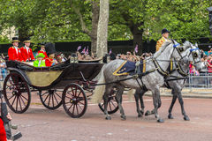 2016 Trooping the Color ceremony during Sovereign's official birthday. Queen Elizabeth II and Prince Phillip in The Queen's Carriage riding along The Mall during Royalty Free Stock Photos