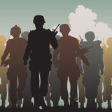 Troops walking. Editable vector silhouettes of armed soldiers walking together Royalty Free Stock Images