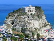 Tropea rock church near a sand beach Stock Photos